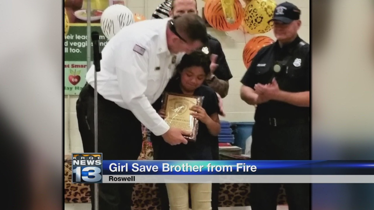 Roswell girl honored for saving little brother from house fire_1527288050400.jpg.jpg