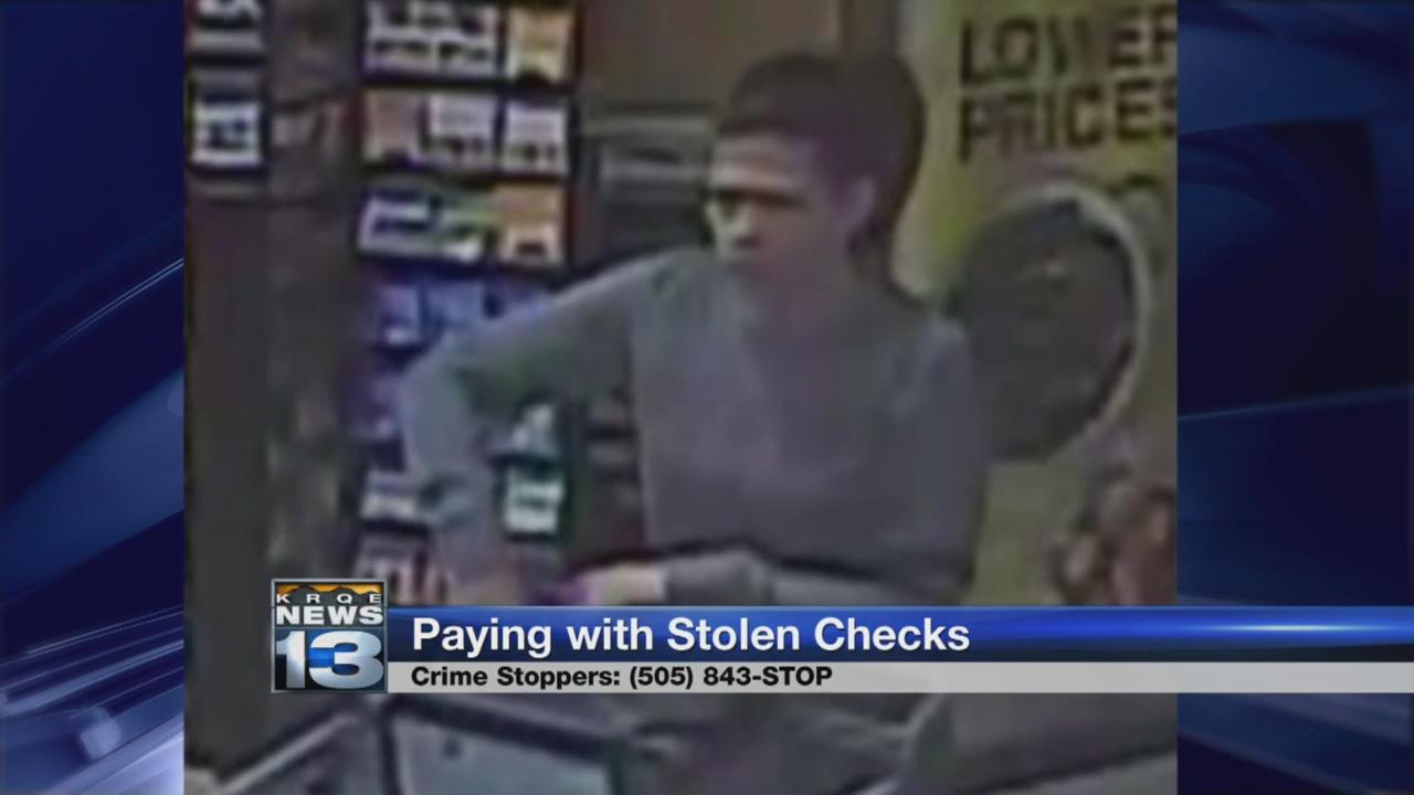 Police seek woman accused of using stolen checks_1529619559949.jpg.jpg