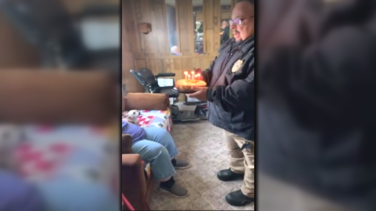 Animal Control surprises woman with groceries and birthday cake_1545872202213.jpg.jpg