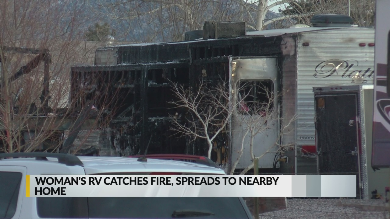 Woman searching for dog after RV catches fire_1547269757793.jpg.jpg