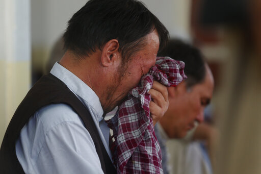 Afghan official: Wedding attack's death toll rises to 80