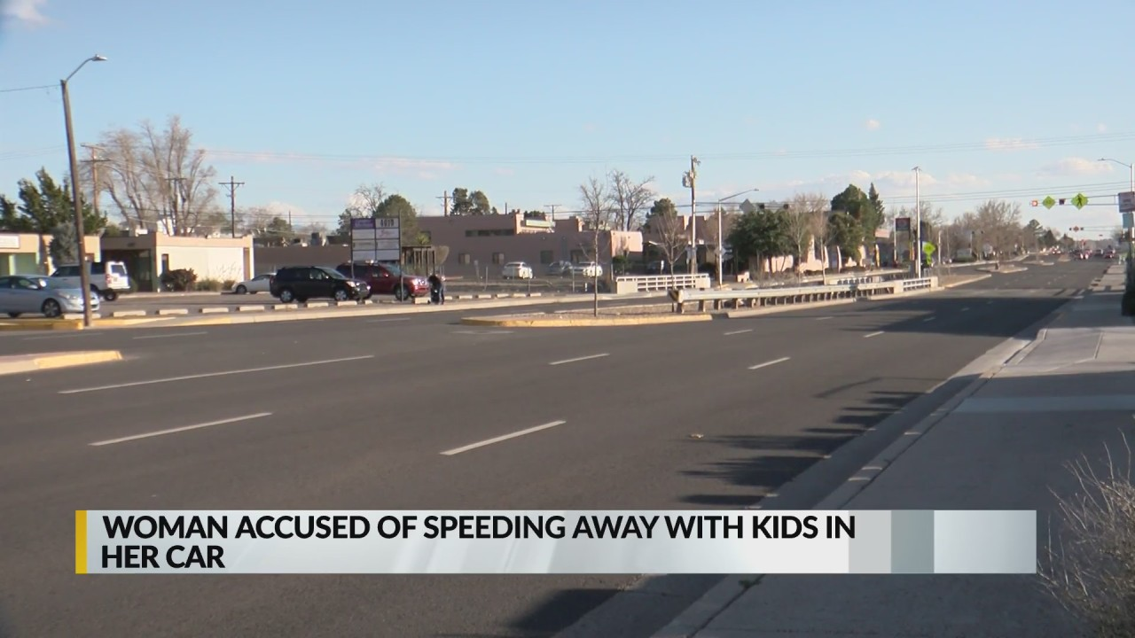 Woman accused of speeding away with kids in car