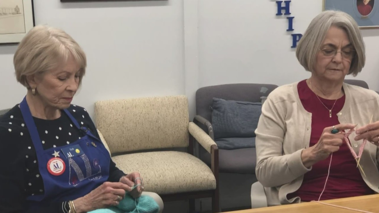 Assistance League of Albuquerque volunteers create handmade knitted caps, blankets for UNMH patients